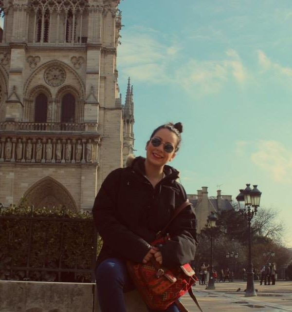 Sitting in front of the Notre Dame in Paris