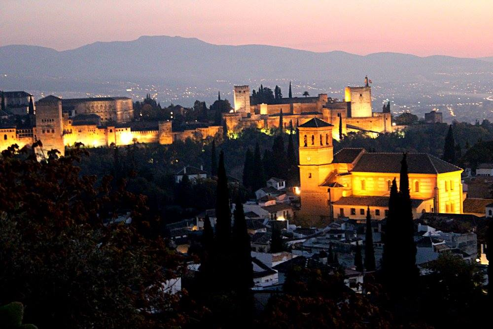 sunset in Granada from the hill of sacramonte, with the Alhambra in the background