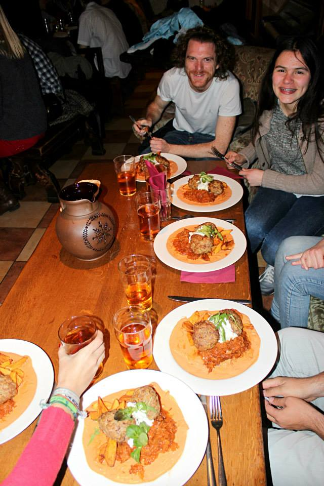 table at Folkklubs Ala Pagrabs full of typical latvia dishes