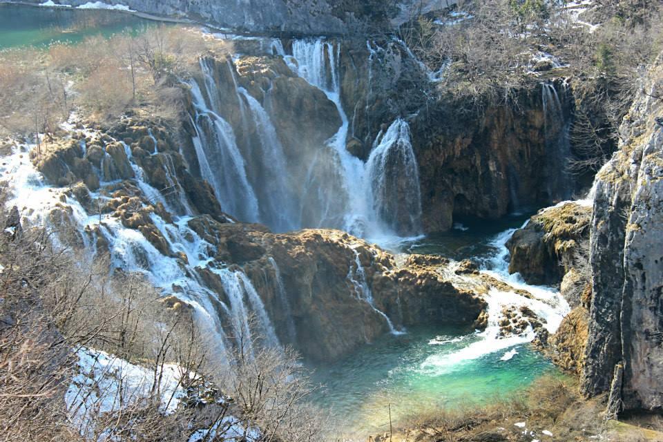 giant waterfalls partially frozen in plitvice lakes