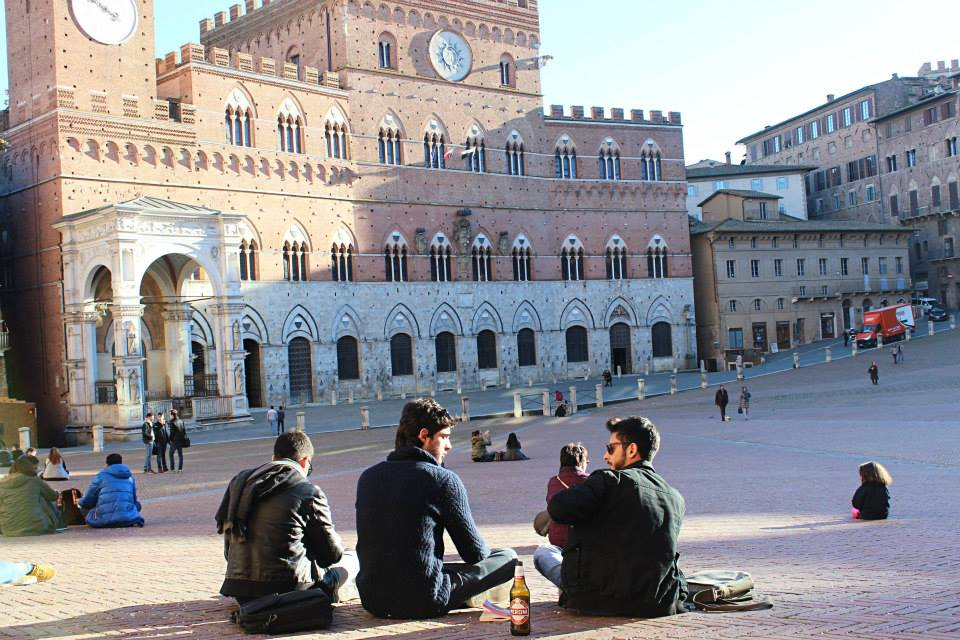 main square in siena with locals hanging out
