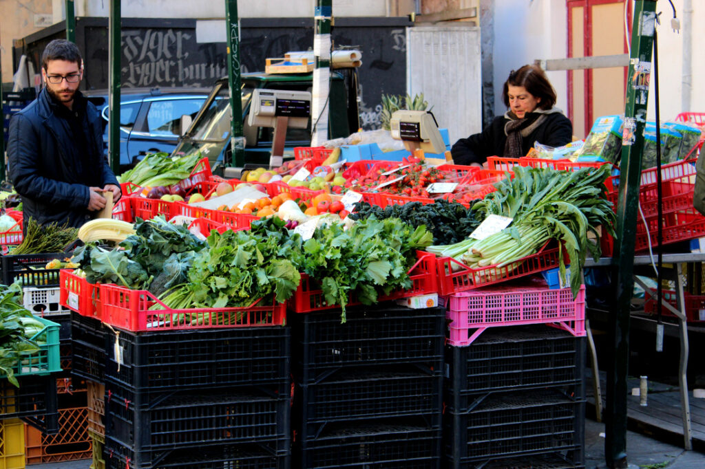street market with fresh veggies and fruit in pisa