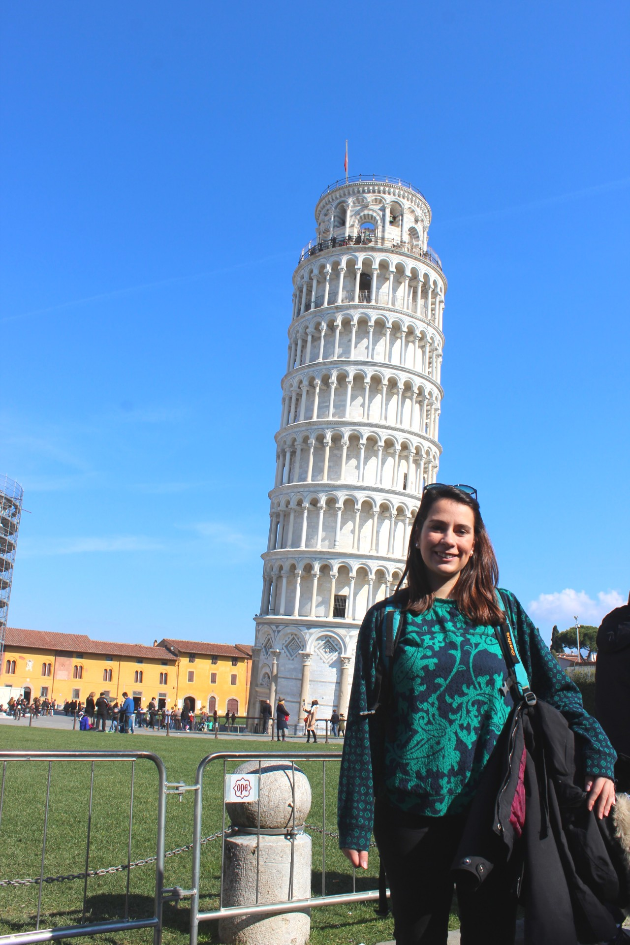 girl with the leaning tower behind her