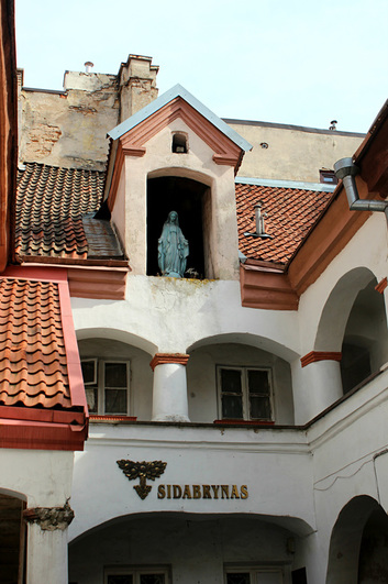 beautiful building in vilnius with religious statue on top