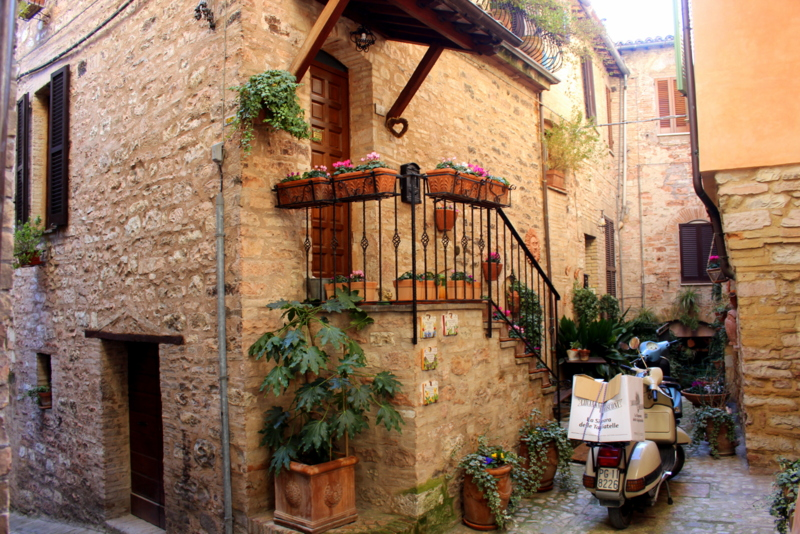 narrow cobbled street of spello in the region of umbria in italy